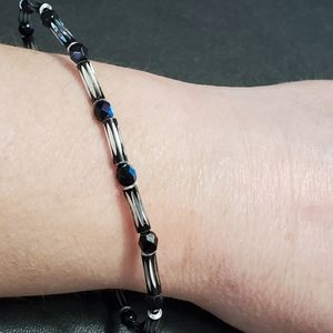 Black and silver colored bracelet
